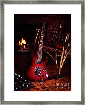 Electric Guitar Propped On Chair Near Fireplace Framed Print by Oleksiy Maksymenko
