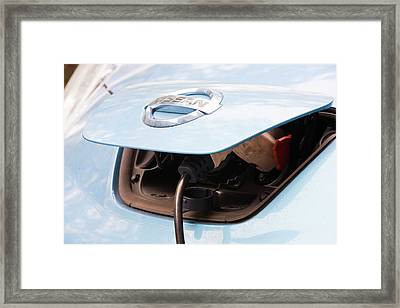 Electric Nissan Leaf And Charging Station Framed Print by Ashley Cooper
