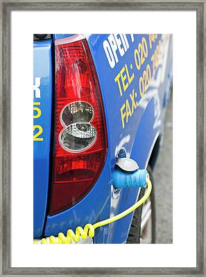 Electric Vehicle At A Charging Station Framed Print by Ashley Cooper