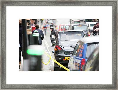 Electric Vehicles At Charging Stations Framed Print by Ashley Cooper