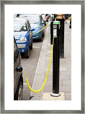 Electric Vehicles At Recharging Stations Framed Print by Ashley Cooper