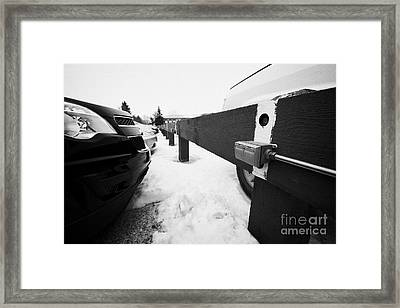 Electrical Power Sockets In Outdoor Parking Lot For Engine Block Heaters Saskatchewan Canada Framed Print by Joe Fox