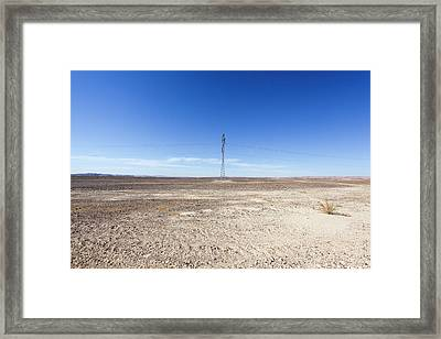 Electricity Pylon In Desert Framed Print by Photostock-israel