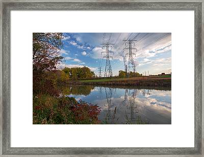Electricity Pylons By A Lake Framed Print by Jim West
