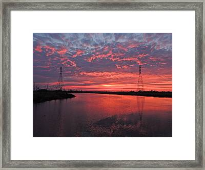 Electrifying Towers Framed Print by Eve Spring