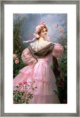 Elegant Woman In A Rose Garden Framed Print