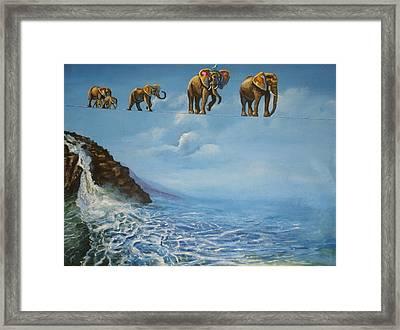 Elephant Family On A Tightrope Framed Print by Barbara Gray