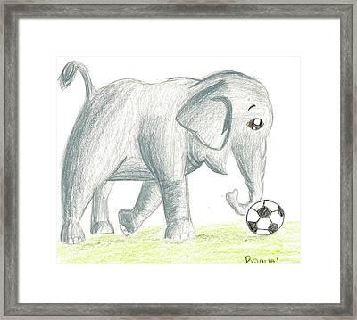 Elephant Playing Soccer Framed Print by Raquel Chaupiz
