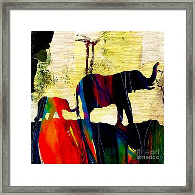 Elephant Walk Framed Print by Marvin Blaine