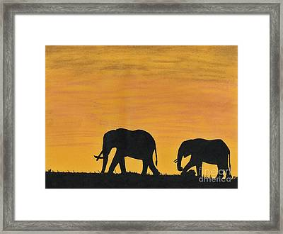 Elephants - At - Sunset Framed Print