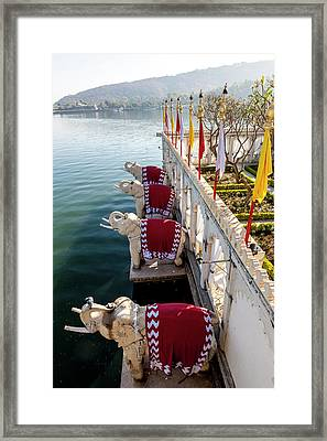 Elephants Guarding Palace Hotel Framed Print by Tom Norring