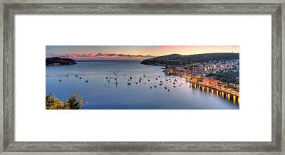 Elevated View Of A City At Dusk Framed Print