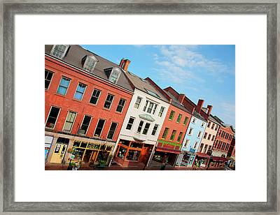 Elevated View Of Storefronts On Market Framed Print