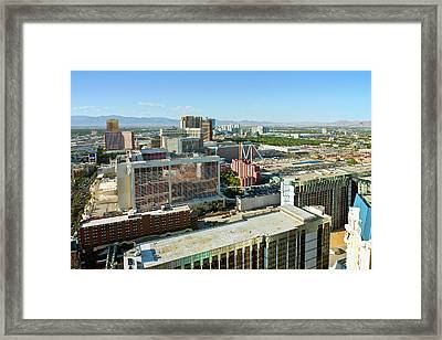 Elevated View Of The City Rooftops Framed Print