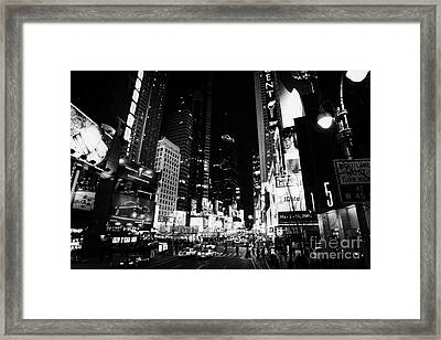 Elevated View Of Times Square In Nighttime New York City Framed Print by Joe Fox