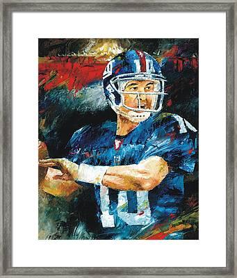 Eli Manning Framed Print by Christiaan Bekker