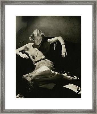 Elissa Landi Posing On A Sofa Framed Print by Edward Steichen