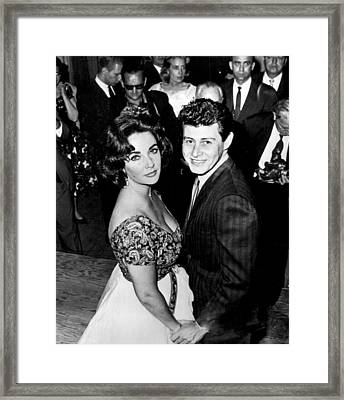 Elizabeth Taylor With Husband In Front Of Others Framed Print by Retro Images Archive