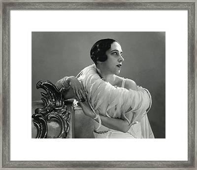 Elsa Schiaparelli Wearing A Feather Boa Framed Print