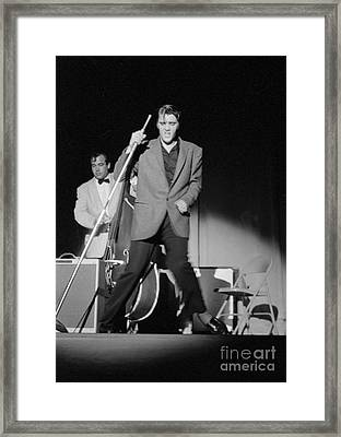 Elvis Presley And Bill Black Performing In 1956 Framed Print by The Harrington Collection