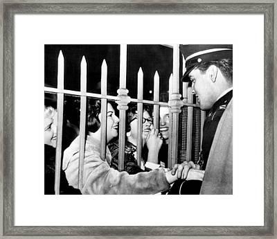 Elvis Presley Embraces Fans Framed Print