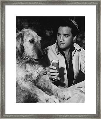 Elvis Presley Has A Milkshake With Dog Framed Print by Retro Images Archive