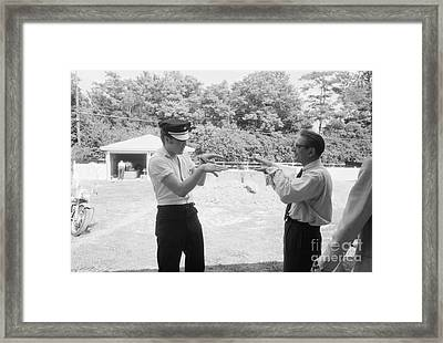 Elvis Presley Horsing Around With A Reporter Framed Print