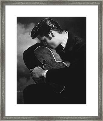 Elvis Presley Kisses Guitar Framed Print by Retro Images Archive