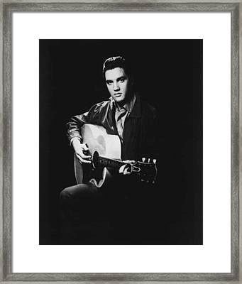 Elvis Presley Playing Guitar Framed Print by Retro Images Archive