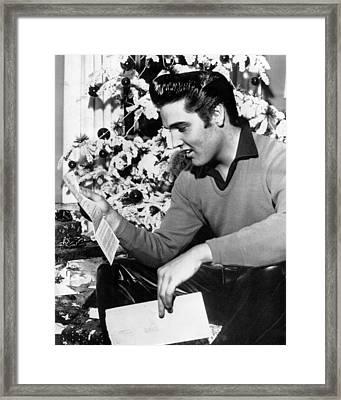 Elvis Presley Reads Letter Framed Print