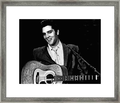 Elvis Presley Smiles While Holding Guitar Framed Print