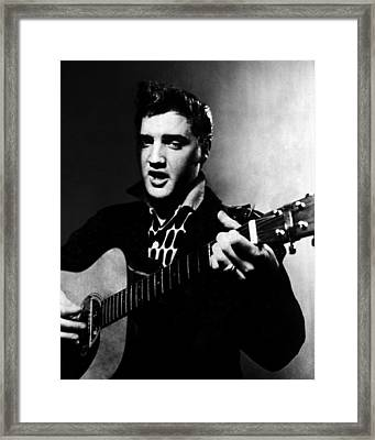 Elvis Presley Strums The Guitar Framed Print by Retro Images Archive
