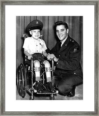 Elvis Presley Takes Time With Boy Framed Print by Retro Images Archive