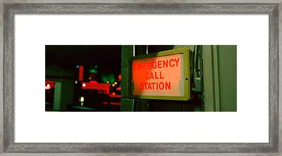 Emergency Telephone Booth In A City Framed Print