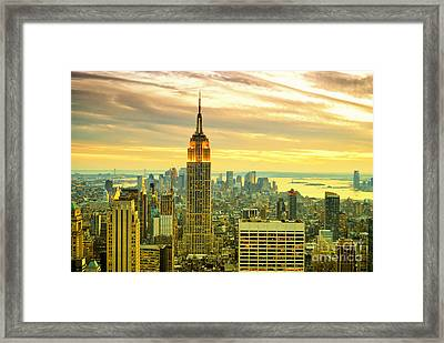 Empire State Building In The Evening Framed Print by Sabine Jacobs