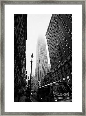 Empire State Building Shrouded In Mist And Nyc Bus Taken From 34th And Broadway Nyc New York City Framed Print