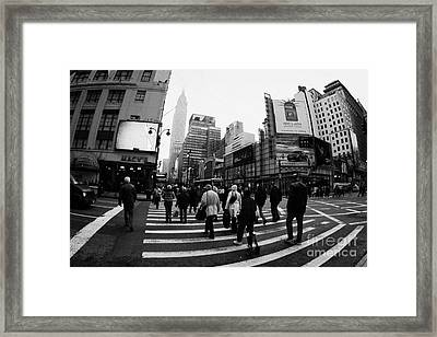 Empire State Building Shrouded In Mist As Pedestrians Crossing Crosswalk  New York City Usa Framed Print by Joe Fox