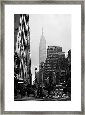 Empire State Building Shrouded In Mist As Pedestrians Crossing Crosswalk On 7th Ave And 34th Street  Framed Print
