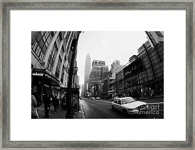 Empire State Building Shrouded In Mist As Yellow Cab Taxi New York City Framed Print by Joe Fox