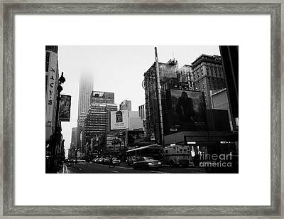 empire state building shrouded in mist from west 34th Street and 7th Avenue new york city usa Framed Print