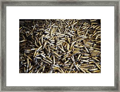 Empty 7.62mm Brass Casings Framed Print by Andrew Chittock