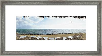 Empty Beach Chairs On The Beach, Key Framed Print