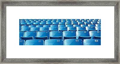 Empty Blue Seats In A Stadium, Soldier Framed Print by Panoramic Images