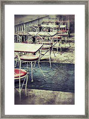 Empty Chairs And Tables Outside At Restaurant Framed Print by Birgit Tyrrell