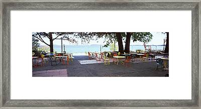 Empty Chairs With Tables In A Campus Framed Print by Panoramic Images