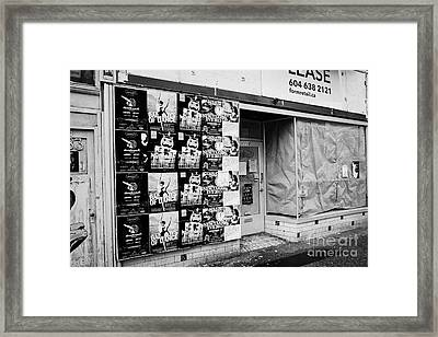 empty downtown store for lease covered in posters Vancouver BC Canada Framed Print by Joe Fox