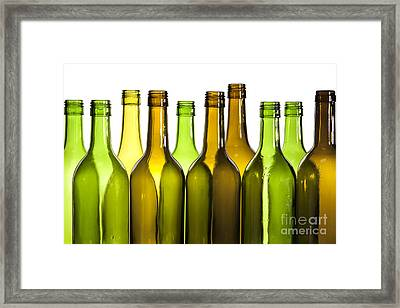 Empty Glass Wine Bottles Framed Print by Colin and Linda McKie