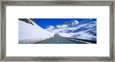 Empty Road Passing Through A Polar Framed Print