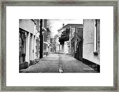 Empty Street In Bruges Framed Print by John Rizzuto