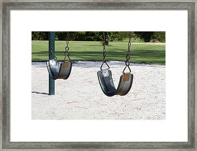 Empty Swings Framed Print